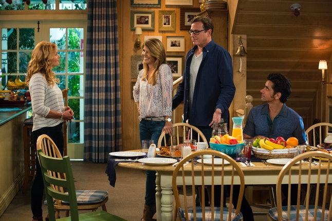 Candace Cameron Bure as D.J., Lori Loughlin as Aunt Becky, Bob Saget as Danny, and John Stamos as Uncle Jesse in Fuller House