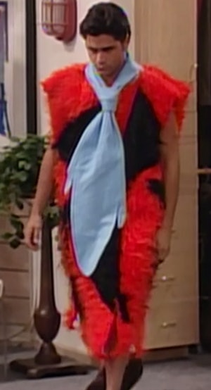 Uncle Jesse wearing a Fred Flintstone costume on Full House