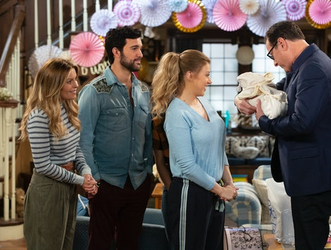 Candace Cameron Bure as D.J., Juan Pablo Di Pace as Fernando, Jodie Sweetin as Stephanie, and Bob Saget as Danny look Steph's baby in Fuller House Season 5