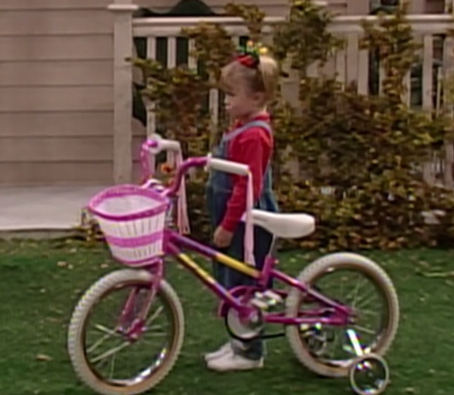 Michelle with her pink bike on Full House