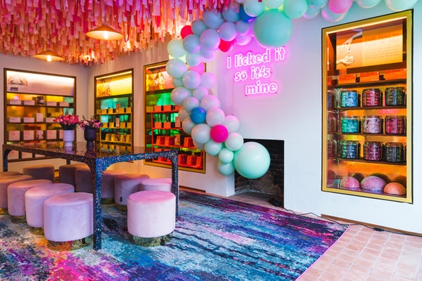 The Smith & Sinclair adult candy shop pop-up has candy on the shelves and vibrant balloons in New York City.