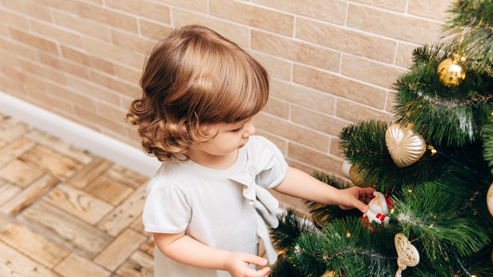 when is christmas 2019? toddler decorating a christmas tree