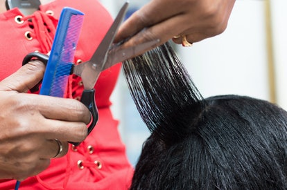 A person gets her hair done in a salon. The chemicals from hair relaxers and permanent dyes may cont...