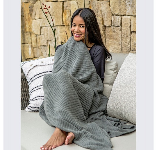 The Barefoot Dreams blanket *does* look as cozy as Chrissy Teigen says it is.