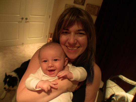 Mom holding baby and smiling