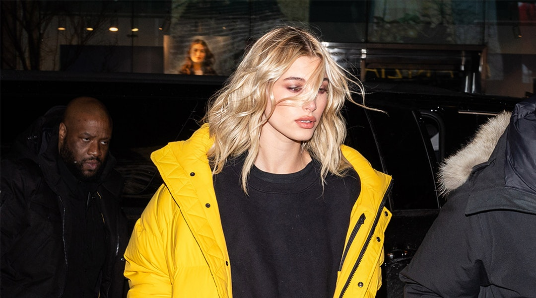 1cf740f35 Hailey Baldwin's Yellow Puffer Coat Is The Fashion Crowd's Winter Staple