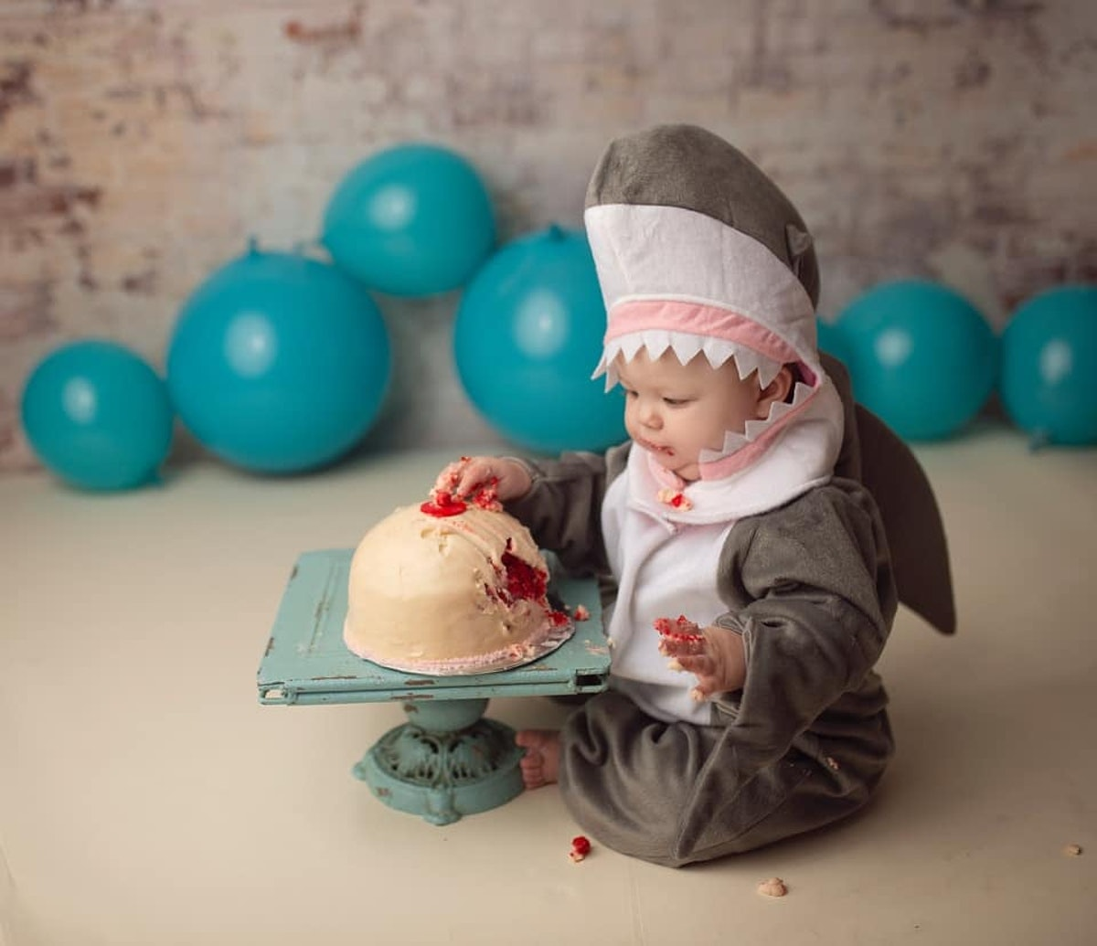 This Baby Shark Cake Smash Is Equal Parts Sweet & Scary For Breastfeeding Moms