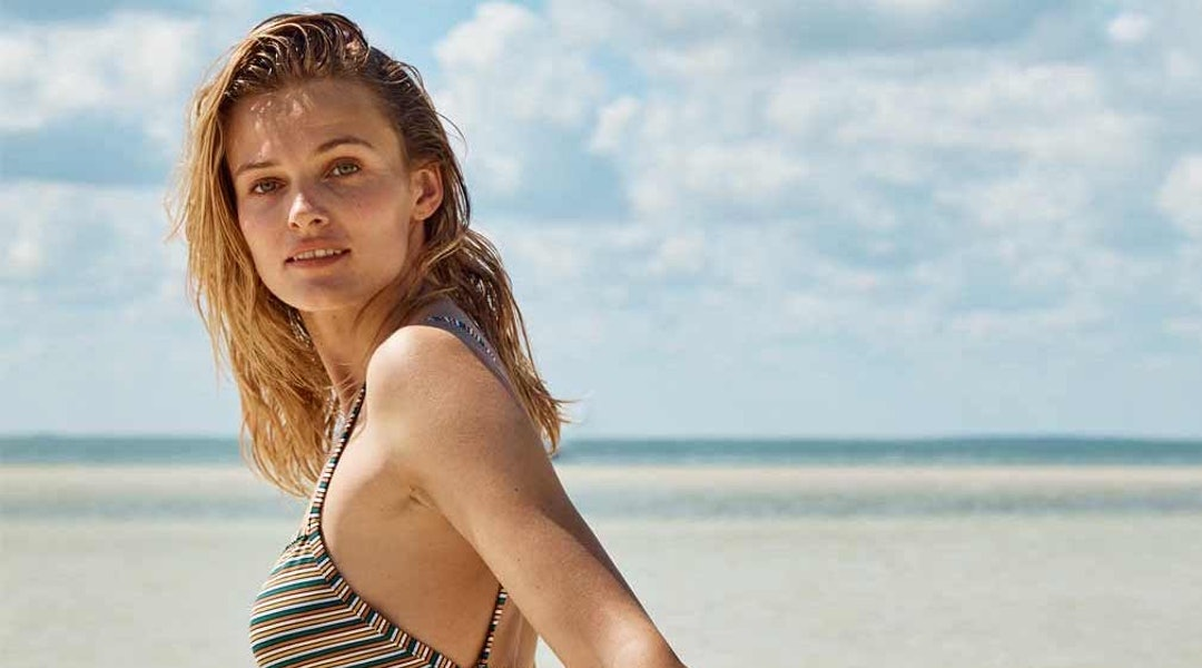 2d55a343de Madewell's Second Wave Swimwear Collection Features Colorful Suits Made  With Recycled Plastic Bottles