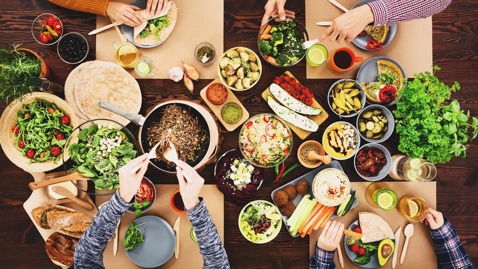 Four friends share a vegan meal. Going vegan without hurting your health is very possible, doctors say