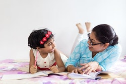 mom and daughter reading books on international women's day