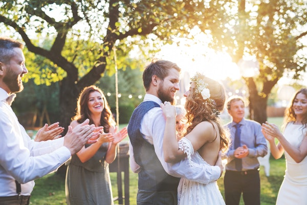 Wedding planners say it's possible to have your big day, as long as you take a few extra precautions.