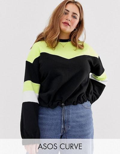 ASOS DESIGN Curve Sweatshirt In Neon Colour Block With Drawstring Hem