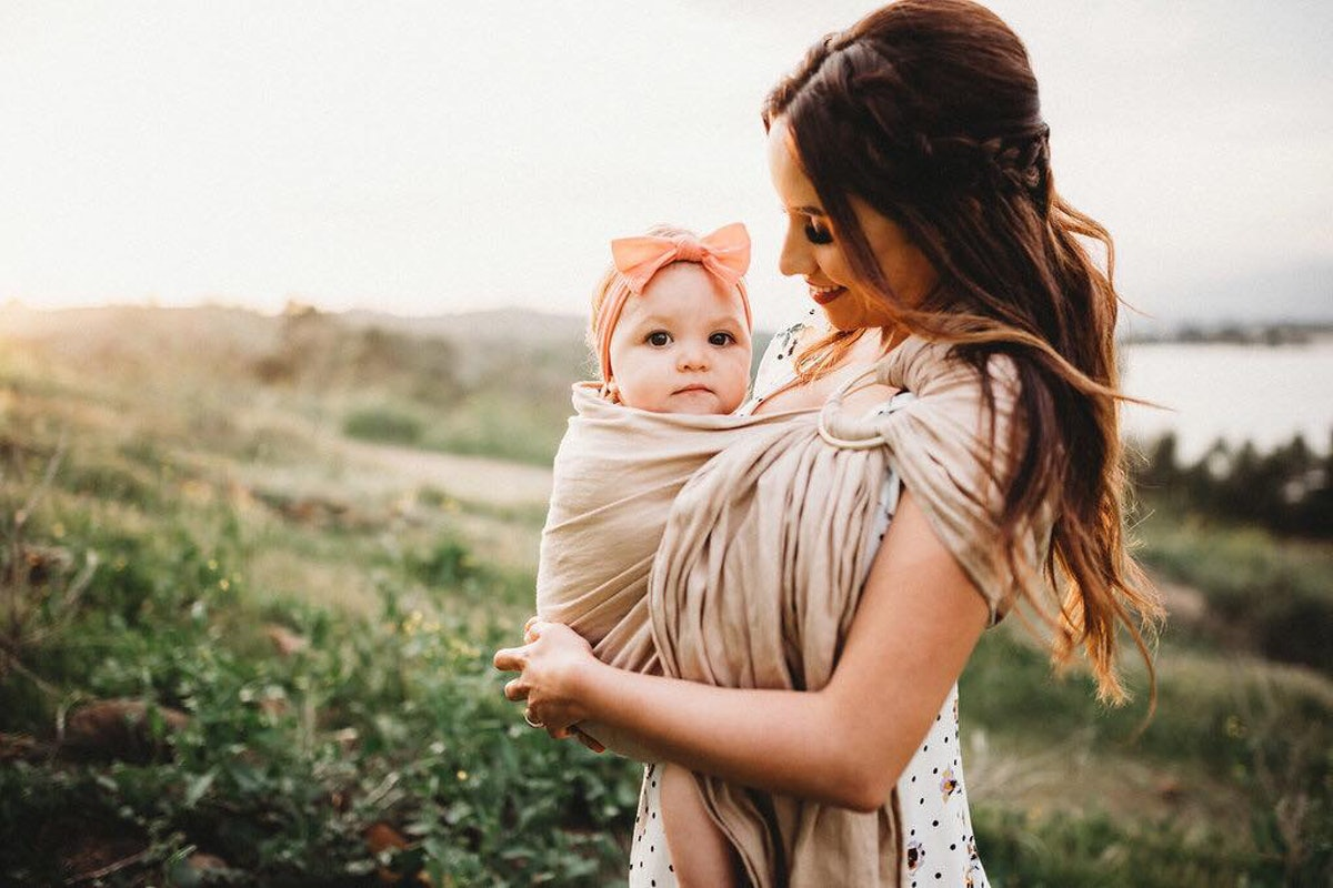 Moms Are *Obsessed* With Babywearing To The Point Of Buying $800 Carriers