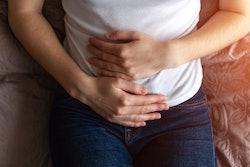 woman holding abdomen