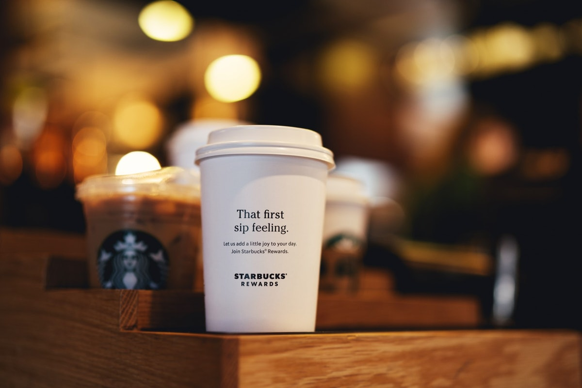 This Starbucks' Rewards Program Update Lets You Use Stars For Merch & Extra Shots