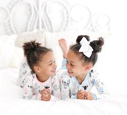 two little girls wearing pajamas