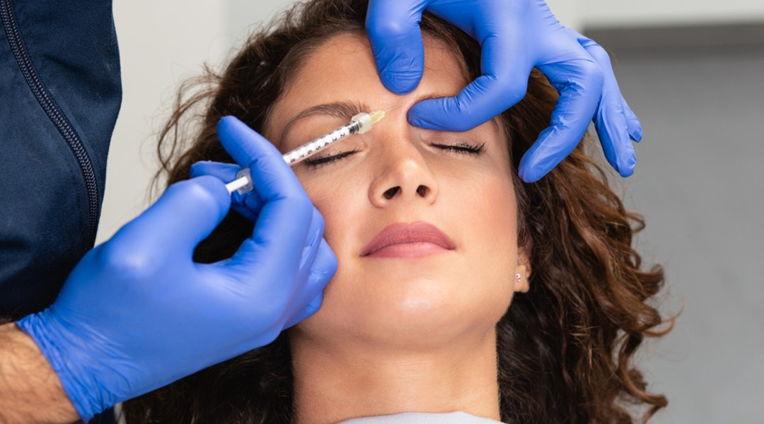 Should You See A Dermatologist Or A Plastic Surgeon For