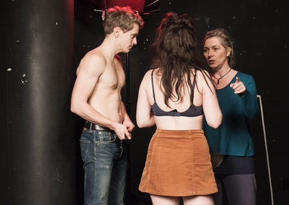 Intimacy Coordinator Ita O'Brien talking to two actors