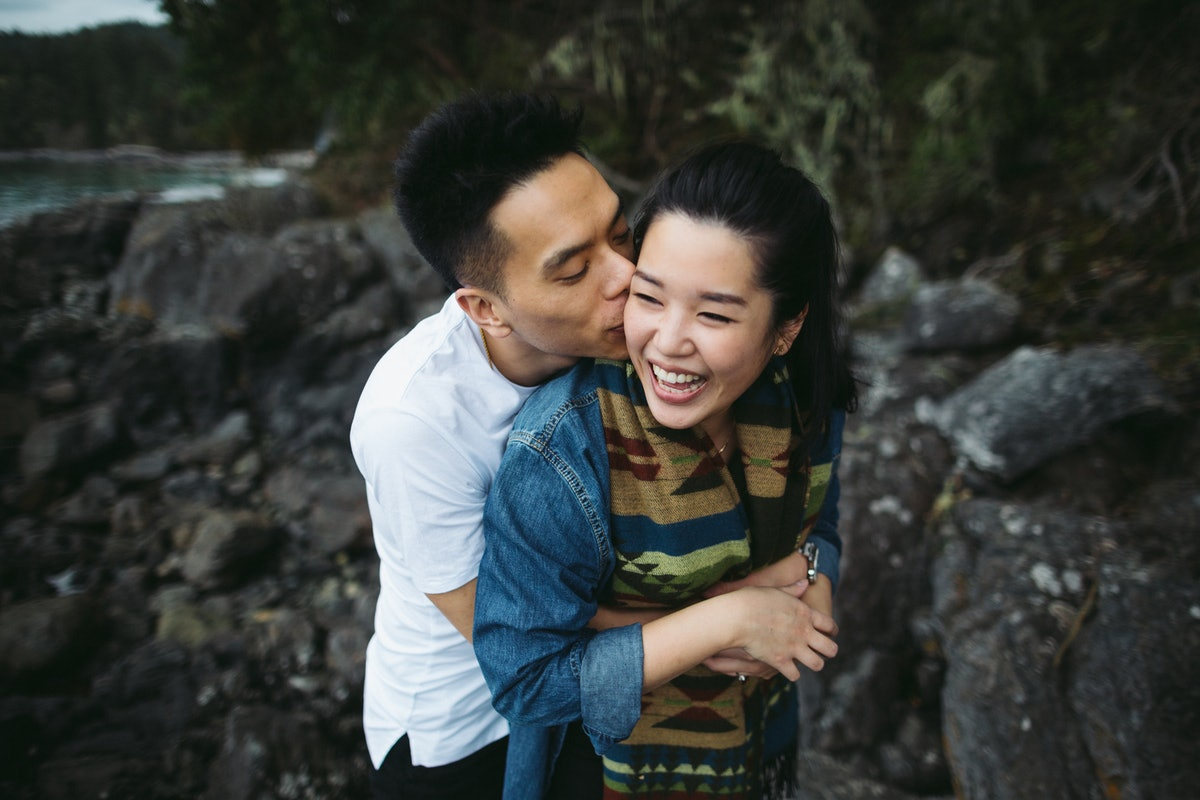 How To Support Your Partner When They're Dealing With Stress, According To An Expert