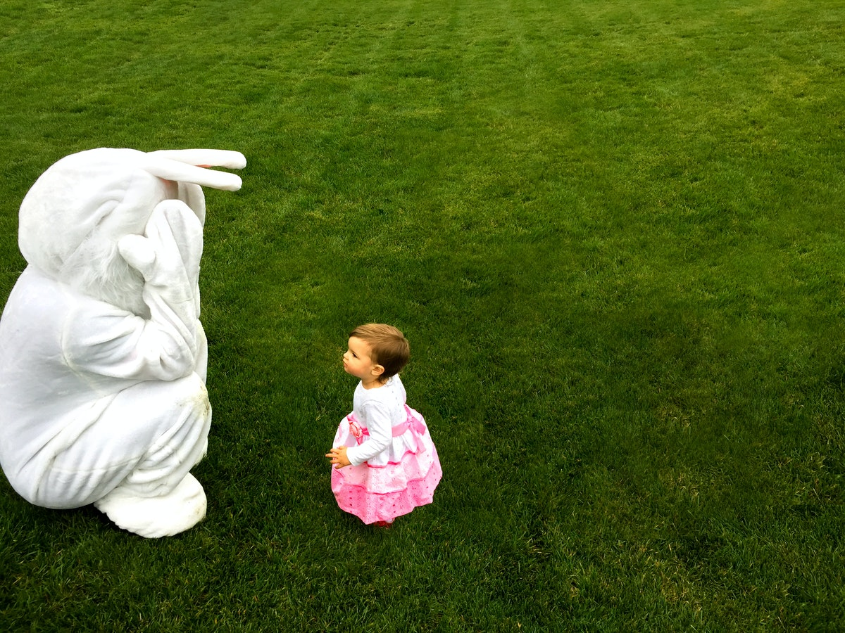 Why You Shouldn't Force Your Kid To Sit On The Easter Bunny's Lap, According To Experts