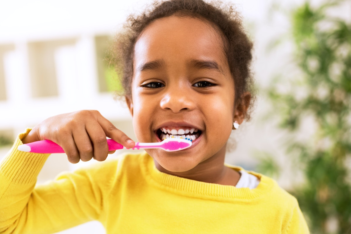Dental Hygiene Is Important For Kids' Self-Esteem & Here's How Parents Can Help, According To An Expert