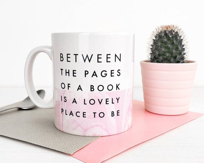 """""""Between The Pages Of A Book Is A Lovely Place To Be"""" Mug"""