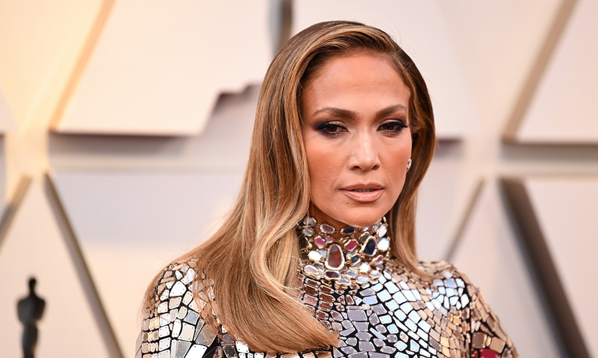 Jennifer Lopez's Pink Raincoat Is A Spring Essential — Here's How She Styles It