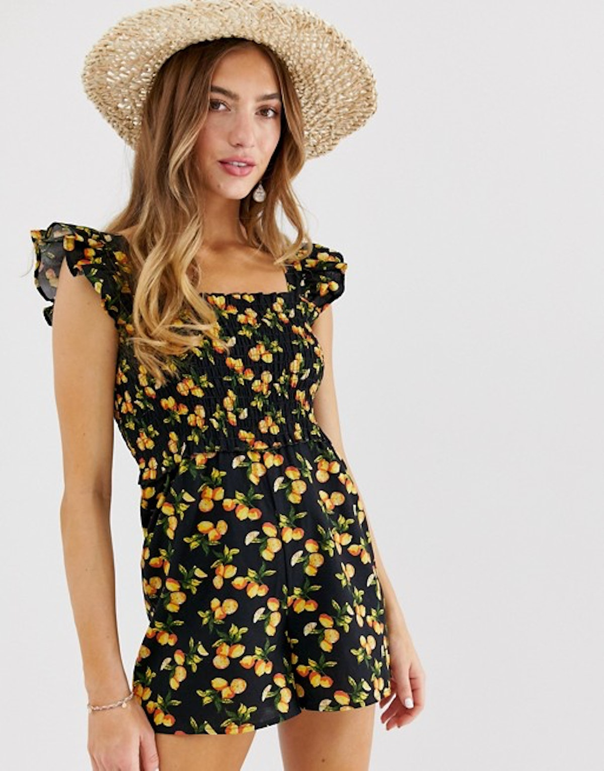 ASOS DESIGN shirred romper with frill sleeve in fruit print