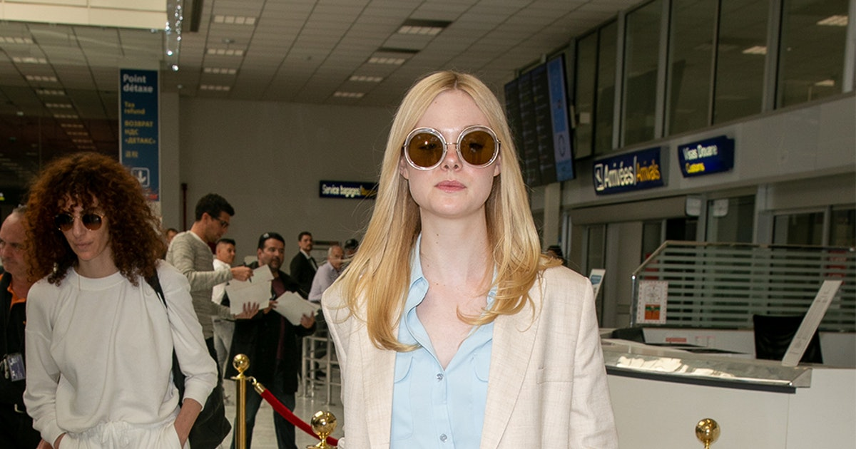 Elle Fanning's Red Belt Bag Is A Chic Approach To The Trend