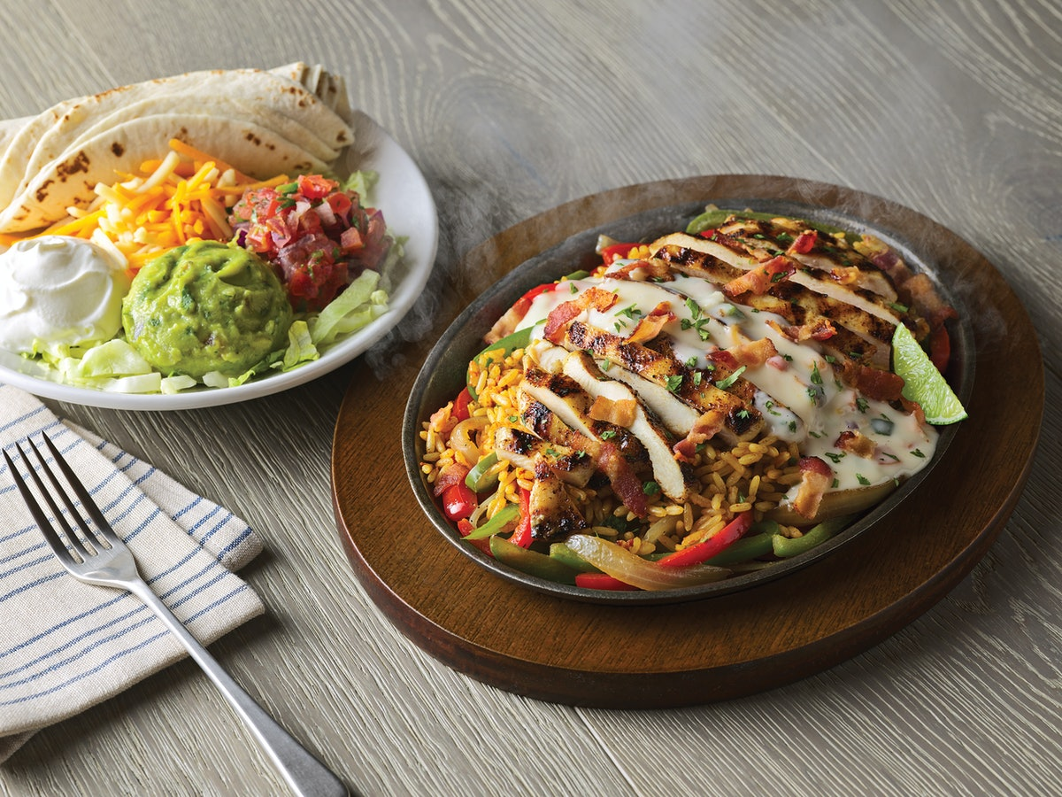 Applebee's' New Loaded Fajitas Topped With Bacon & Queso Are A Tasty Upgrade
