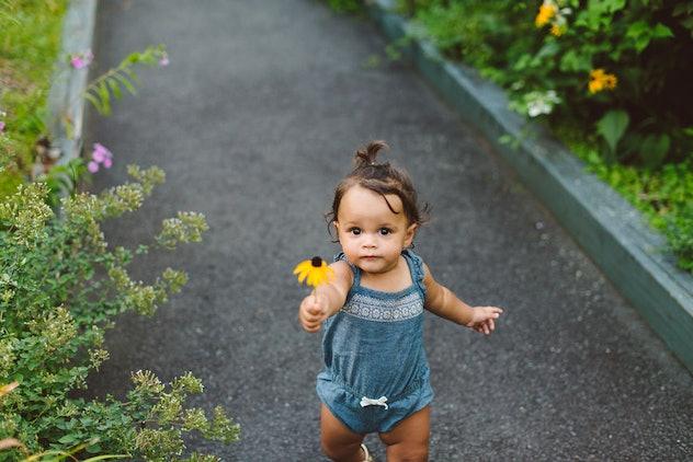 baby exploring a garden