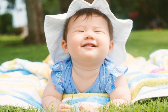 baby girl on lawn, smiling