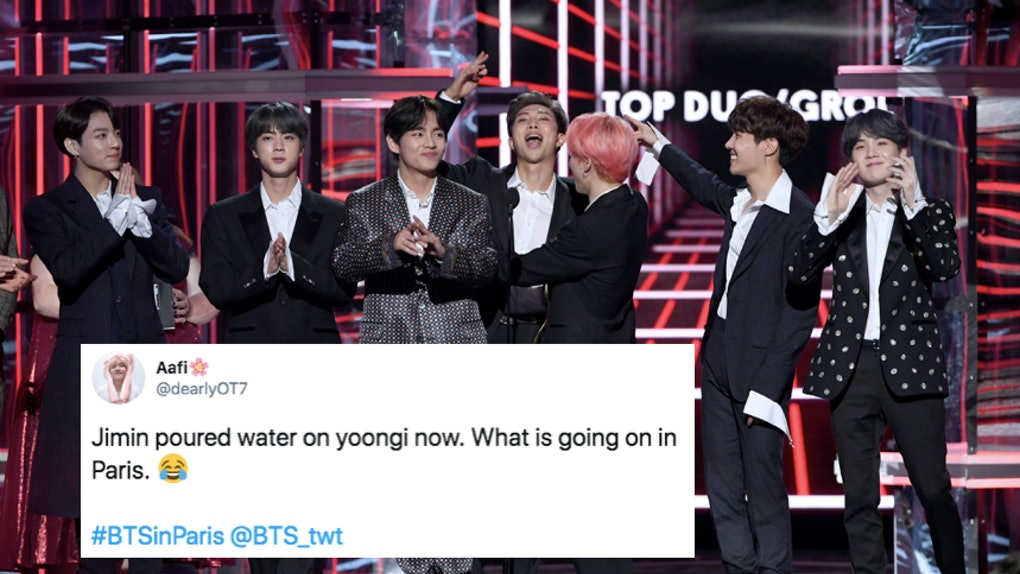 The Videos Of BTS' Water Bottle Fights In Paris Have ARMYs