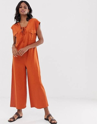 ASOS DESIGN Minimal Jumpsuit with Lace Up and Pockets