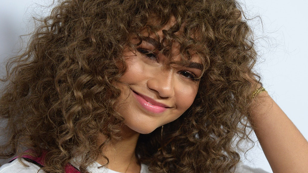 Can I Get Bangs With Curly Hair A Hairstylist Breaks Down The Best Approach For Curly Bangs