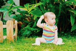 Your baby pulling on their hair is pretty common and is a self-soothing idea for them.