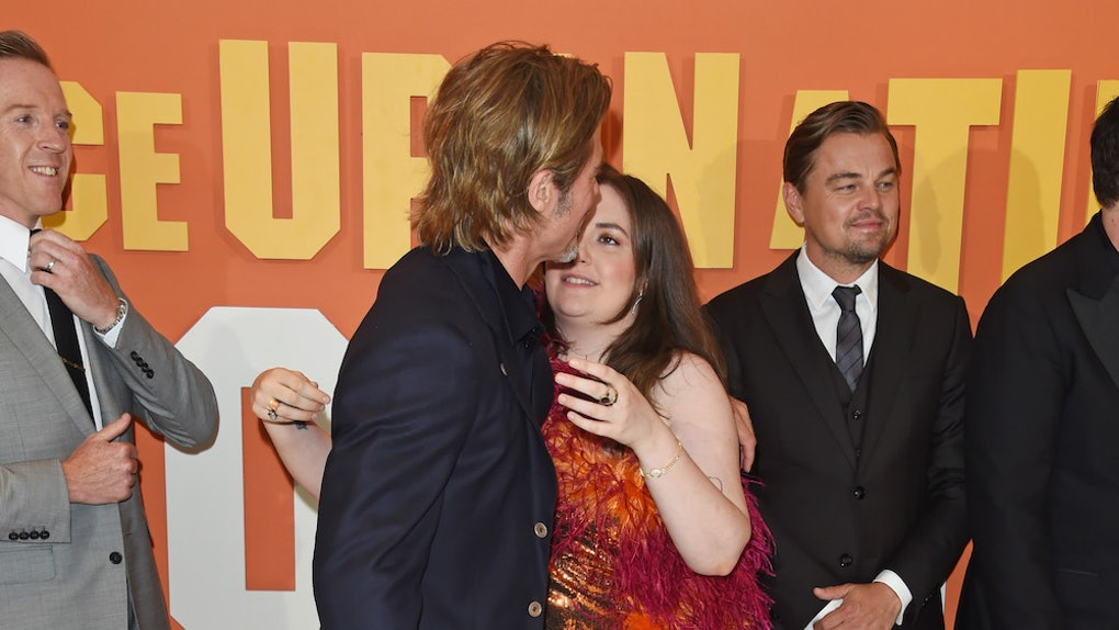 A photo of Lena Dunham appearing to awkwardly kiss Brad Pitt has people talking about the double standards of consent