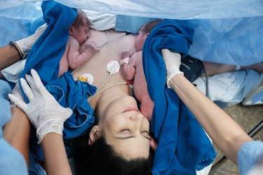 mom breastfeeding newborn twins immediately after c-section