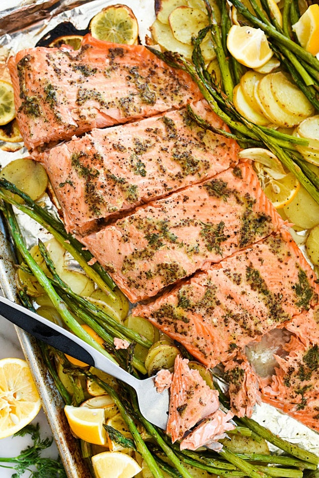 image of gluten free sheet pan mustard salmon, cooked over shaved potatos and asparagus