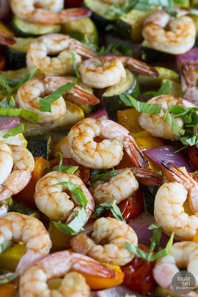 image of gluten-free sheet pan recipe featuring a closeup of shrimp with summer veggies and basil
