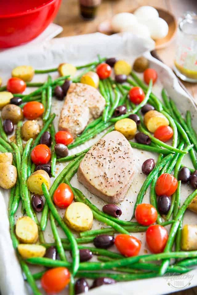 image of gluten-free sheet pan recipe for salad nicoise with salmon, green beans, potatoes and olive...