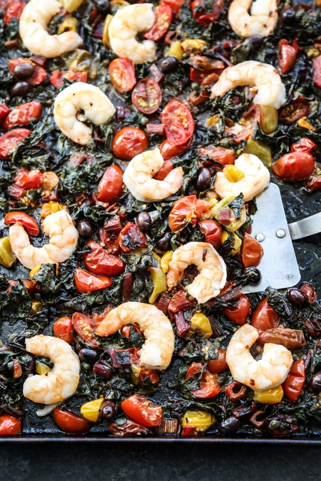 gluten-free sheet pan recipe with shrimp olives capers tomatoes and greens