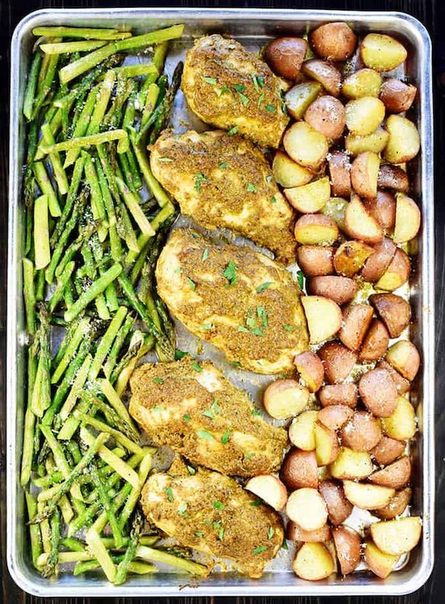 gluten-free sheet pan recipe featuring pesto chicken and vegetables, shot from above