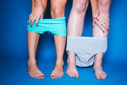 Two people with their underwear around their ankles. Bleeding after sex might be caused by endometriosis.
