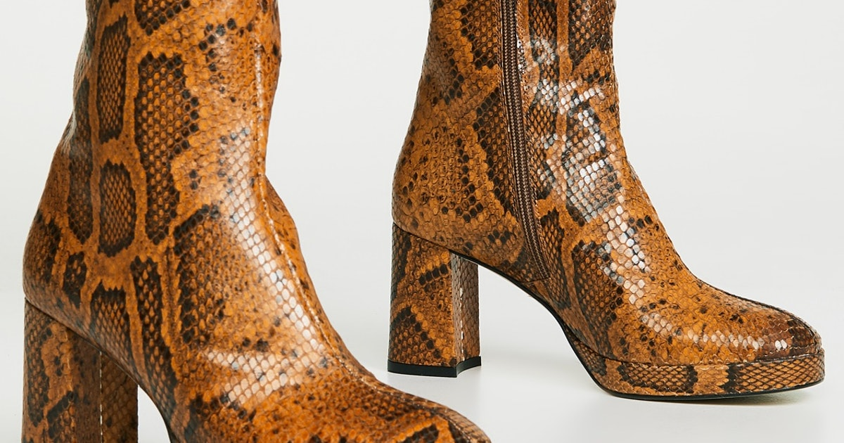 2019's Snakeskin Boots Trend Is Stronger Than Ever & These Are The Styles Everyone Will Be Wearing