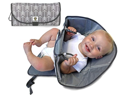 3-In-1 Changing Pad, Diaper Clutch, and Redirection Barrier
