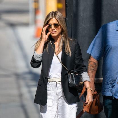 Jennifer Aniston wearing black blazer and white pants on May 2019.