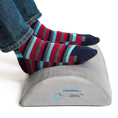 Ergonomic Foot Rest Cushion  Source: Amazon