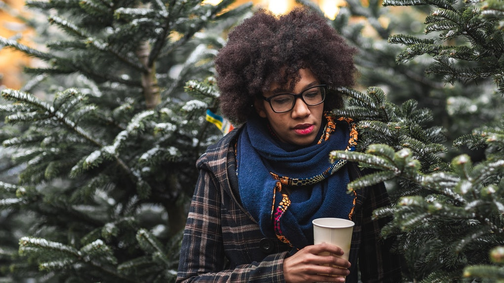 Young Black woman in snowy scene