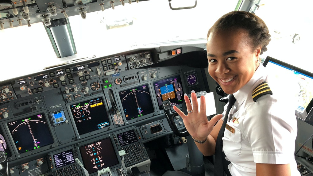 Monique Grayson, a pilot for Delta Airlines, sits in the flight deck of an aircraft.
